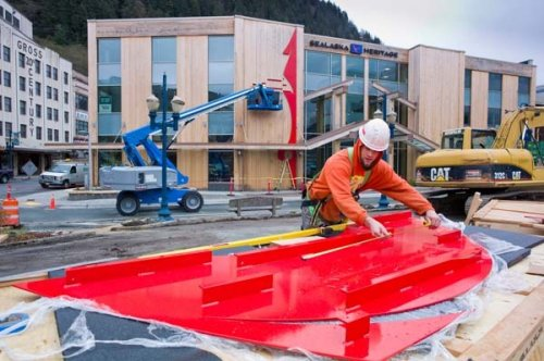 Coleman Stanford of Dawson Construction prepares bright red metal panels for installation onto the new Walter Soboleff Center on April 29.