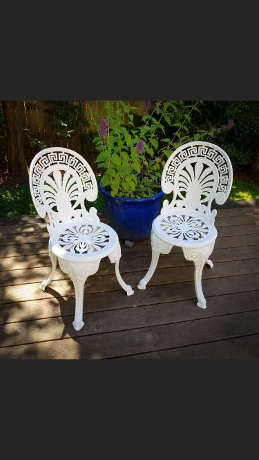 Connie K cast alum chairs